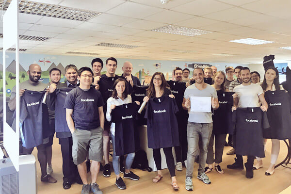 Sendible team at the office in 2017 with Facebook shirts